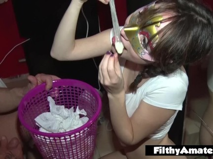 Depraved teen drinks cum from used condoms! DP in real orgy